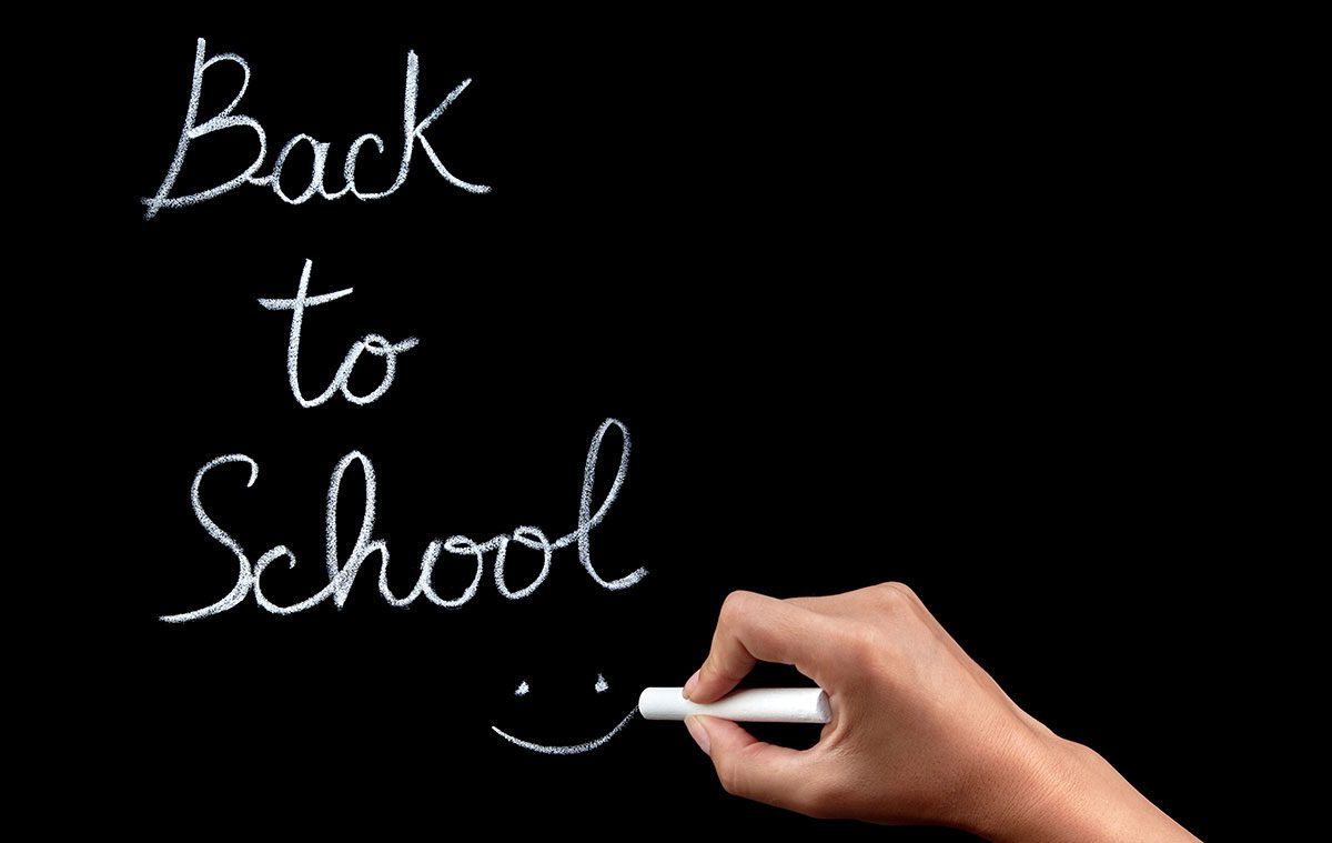 """back to school"" on a chalkboard"