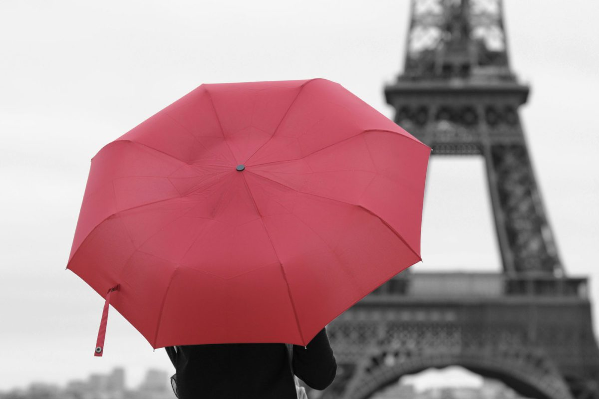 red umbrella in front of Eiffel Tour