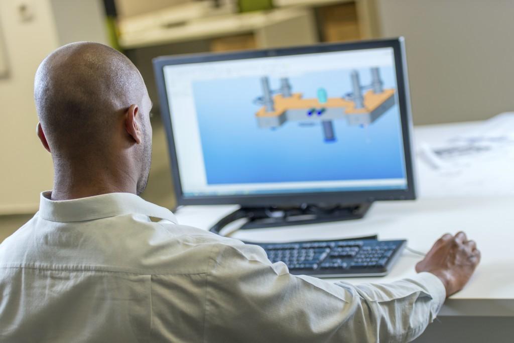 engineering looking at computer model
