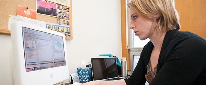 Julie Simons works at a computer in her office