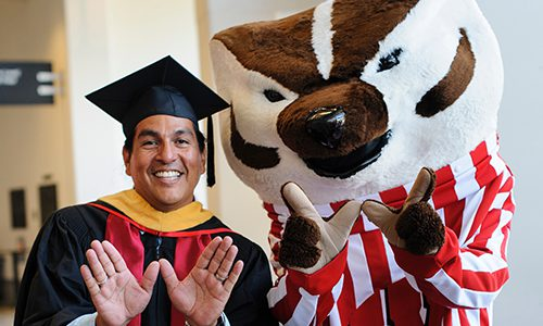 UW-Madison graduate poses with Bucky Badger