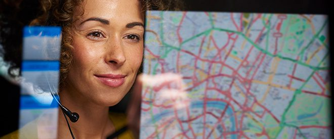 Woman looks at a map on a computer screen