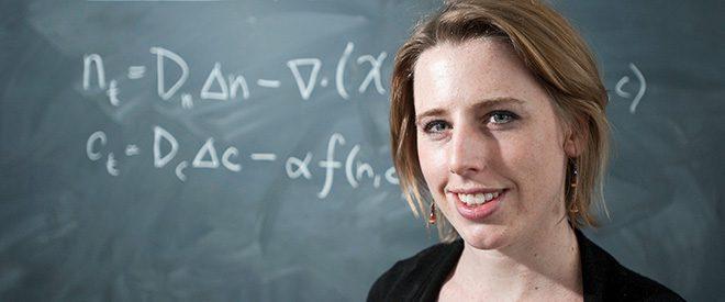 Math Professor Julie Simons in front of a chalkboard