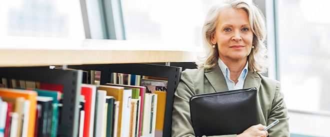 Woman in library with briefcase