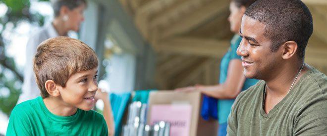 a social worker talks to a boy
