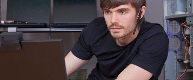 Computer scientist working on laptop