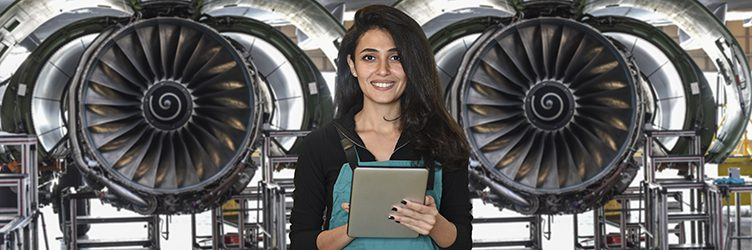 Young female engineer using digital tablet for airplane mechanics