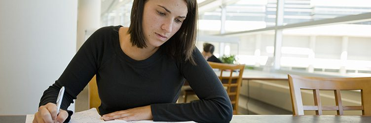 Student Jamie Carroll studies in the Ebling Library inside the Health Sciences Learning Center at the University of Wisconsin-Madison