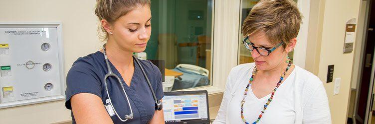 a nurse works with a patient